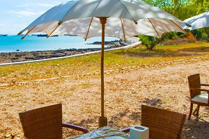 Dining Table and umbrella.