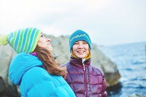 laughing girlfriend near the sea in winter
