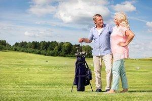 Senior couple enjoying golf game.