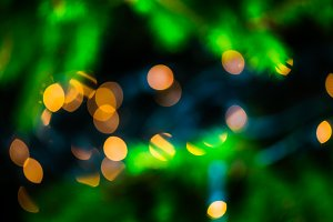 Yellow bokeh background of lights on the Christmas tree