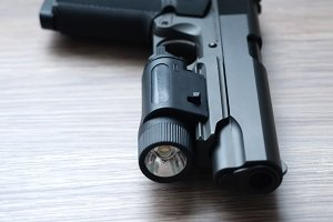 Custom build tactical .45 caliber pistol with weapon light.Shallow depth of field
