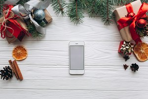 Smartphone and christmas gifts.