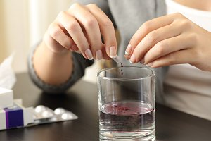 Woman hands dissolving a capsule