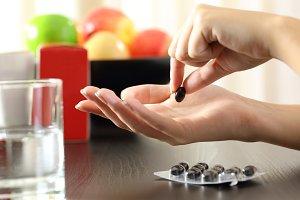 Hands catching a vitamin complex