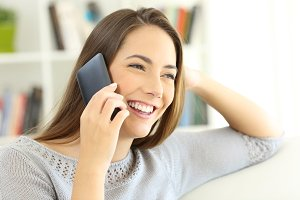Happy lady talking on mobile phone