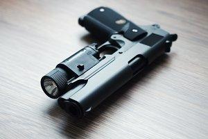 .45 ACP caliber tactical custom build pistol, shallow depth of field