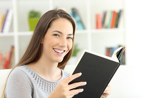 Happy reader girl reading a book