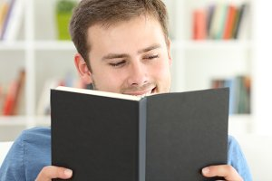 Happy man reading a good book