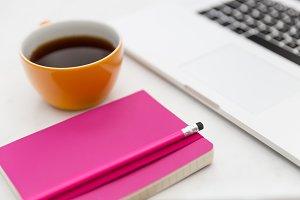 Coffee pink notebook + laptop