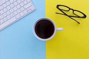 Coffee computer eyeglasses on yellow