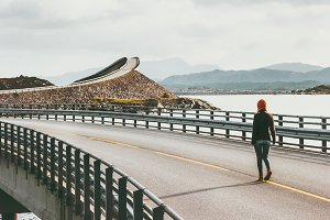 Woman walking alone at Atlantic road