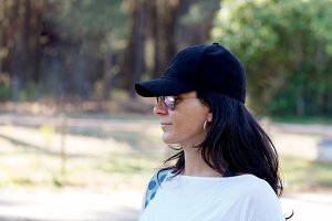 Mature woman with black hat relaxed