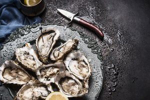 Open oysters with knife