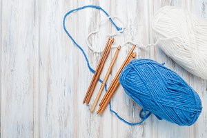 White and blue yarn and hooks