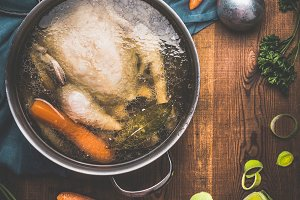 Chicken soup cooking, rustic style