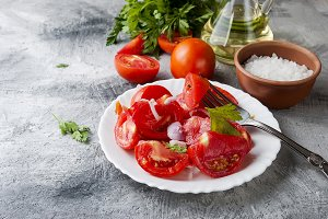Salad of ripe red tomatoes