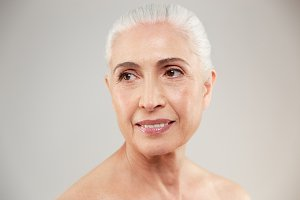 Beauty portrait of an attractive naked elderly woman