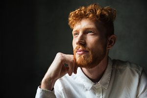 Close up portrait of a pensive young redhead man