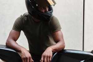 Portrait of a modern young afro american man in helmet