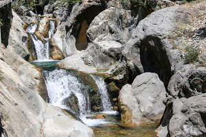 Waterfall in mountain canyon