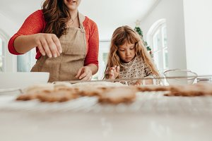 Woman and girl making cookies