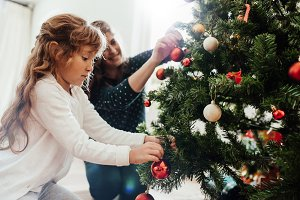 Mother and daughter decorating