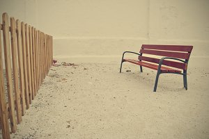lonely bench after the fence