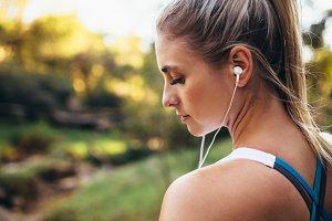 Woman runner wearing earphones