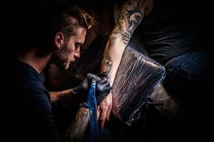 Bearded tattoo artist