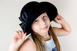 Little girl in black hat