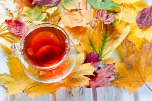 Cup hot tae and autumn leaves