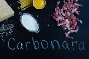 Ingredients for Pasta Carbonara on dark background