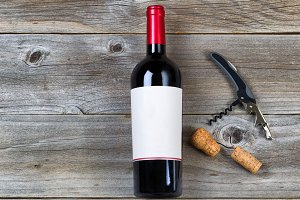 Red Wine Bottle on Wood with opener