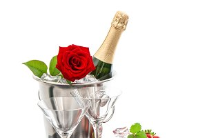 Champagne, red rose and strawberries