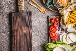 Cutting board and burger ingredients