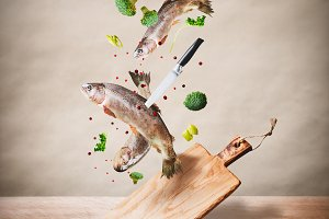 Fish with cutting board and knife