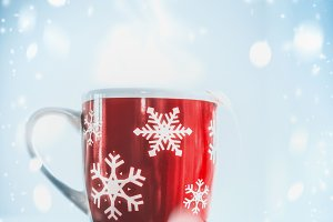 Mug of tea at  frosty winter day