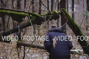girl photographer walking in the autumn forest, the first snow. slow motion