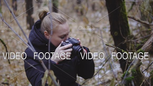 The Photographer The Girl Walks On An Autumn Wood And Takes Pictures Of The Nature First Snow Cinematic Shot Slow Motion Traveler