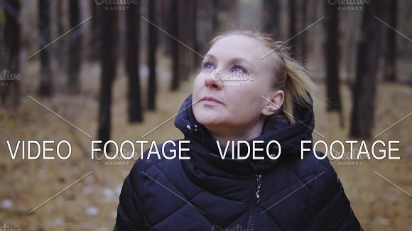 Cinematic Shot Slow Motion The Blond Girl Is Walking Along The Autumn Forest In The Jacket First Snow
