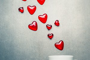 Cup with flying red hearts