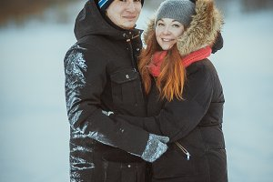 Young couple on winter outdoors portrait.