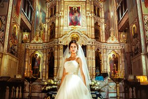 Stylish elegant bride on background the old church