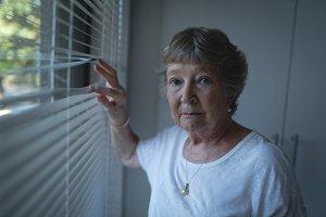 Senior woman standing near window
