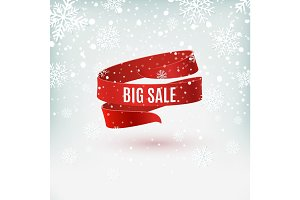 Big sale. Red ribbon on winter background.