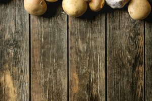 Raw organic potatoes and onion