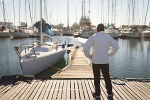 Yachtsman standing on the pier