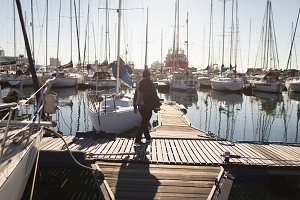 Yachtsman walking on the pier