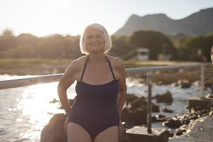 Senior woman in swimsuit standing