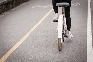 Woman cycling in the road